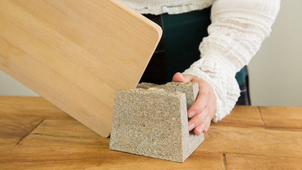 woman-take-cutting-board-from-stand