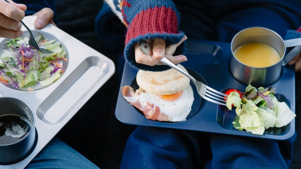 woman-eating-breakfast-on-the-tray