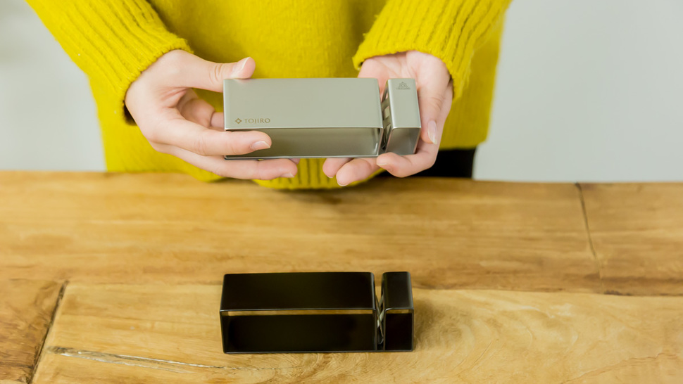 woman-holding-one-of-two-sharpeners