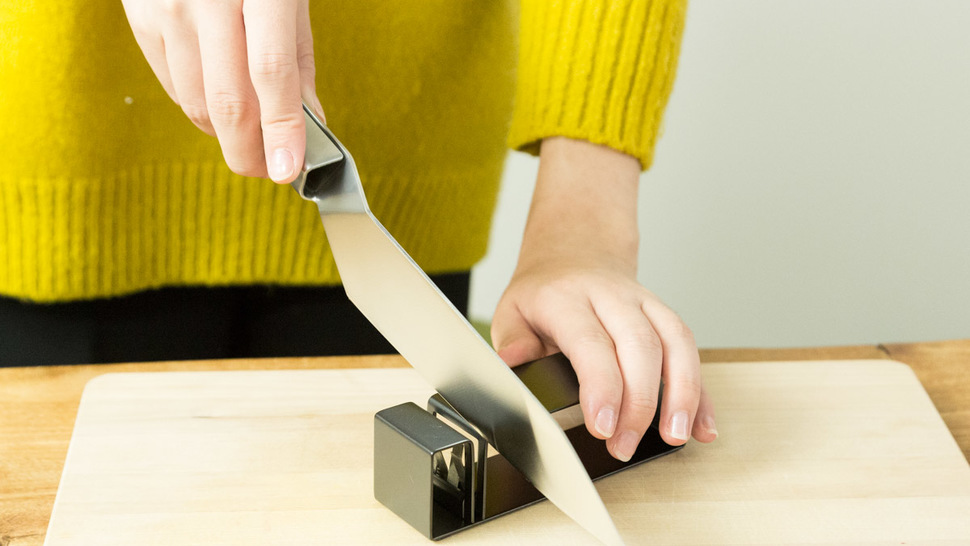 woman-holding-knife-sharpener