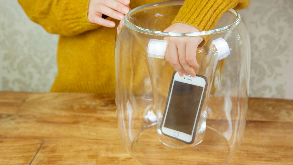 woman-put-smartphone-in-the-speaker-on-the-table