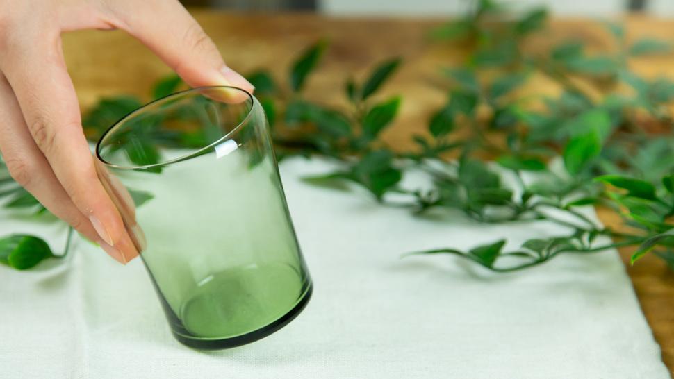 woman-taking-green-glass