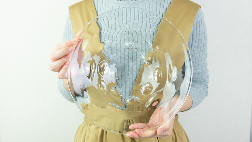 woman-holding-big-clear-plate
